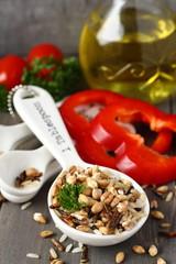Uncooked multigrain rice in porcelain measuring spoons