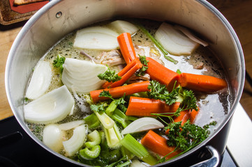 Stock pot with cut vegetables for soup