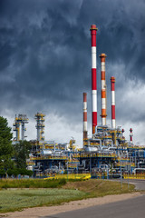 Oil industry refinery factory with dramatic sky.