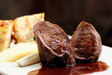 Venison meat steak with Quiche pie, Port sauce, herbs and Potato