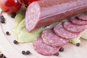 sliced salami with Cherry tomato and seasoned with black pepper
