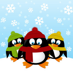 Cute cartoon penguins on winter background