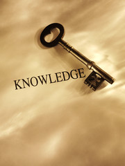 Old church key with the word knowledge