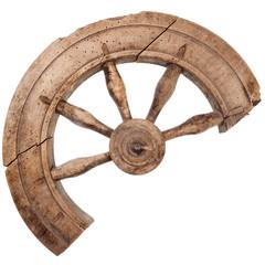 Broken wooden vintage spinning wheel