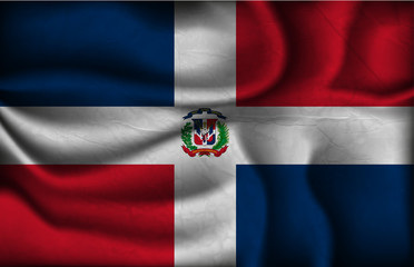 crumpled flag of Dominican Republic on a light background