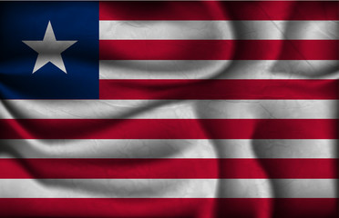 crumpled flag of Liberia on a light background