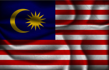 crumpled flag of Malaysia on a light background