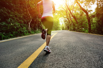 fitness woman running at  forest road
