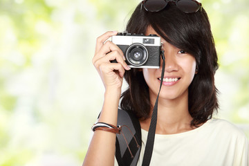 girl taking picture with vintage camera