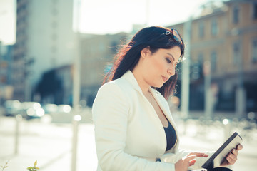 beautiful long black hair elegant business woman using tablet