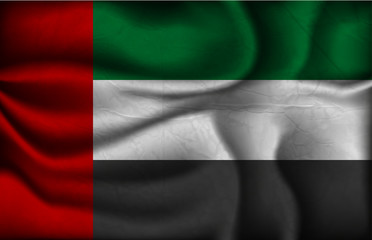 crumpled flag of United Arab Emirates on a light background