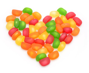 Colorful candies are in shape of heart.