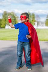 Superhero standing with arm raised