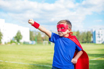 Superhero standing with raised arm and calling up