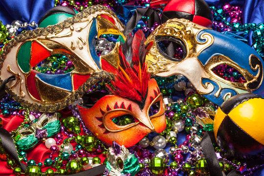 Three Mardi Gras Masks and Beads