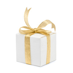 Gift box with golden ribbon bow on white background