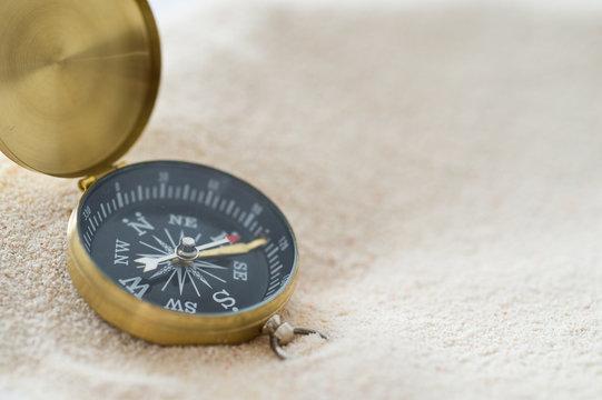 compass on sand