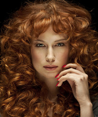 Pretty red-haired girl with curls and freckles