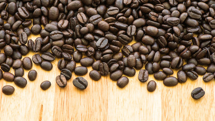 Coffee bean background on plank