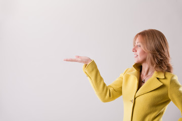 blonde woman holding up COPY SPACE