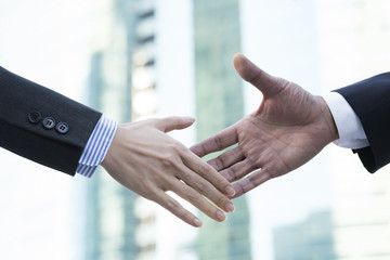 The handshake to businessman