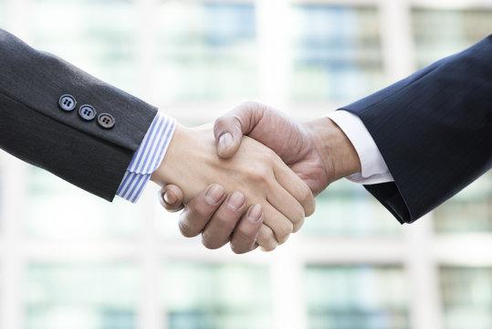 Firm handshake of businessman