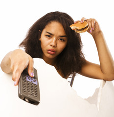 young fat african american teen girl with remote and hamburger