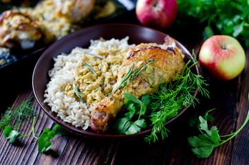 Baked chicken leg with rice garnish