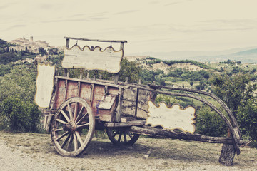 Old wooden cart against vineyards, Tuscany, Italy.