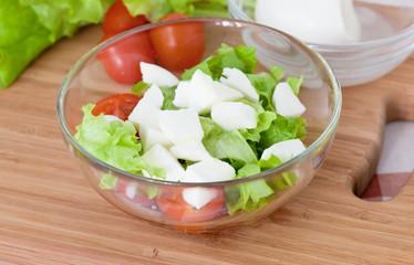 Italian salad from cherry tomatoes, a mozzarella and lettuce