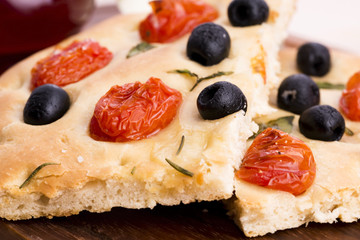 Focaccia with black olives, tomatoes and basil