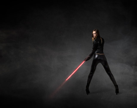 girl in a futuristic military version with laser sword