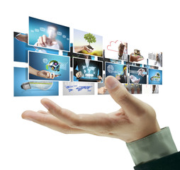 Man pushing on a touch screen digital photos
