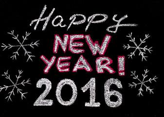 Happy new year 2016, hand writing with chalk on blackboard