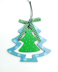 blue wooden toy Christmas tree on a white background