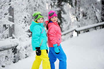 Two kid girls in winter park