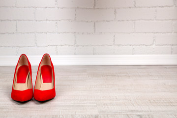 Red women shoes with  on the floor