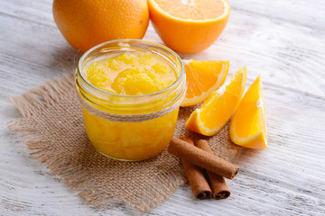 Delicious orange jam on table close-up