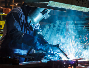 Welder working steel