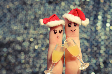 Finger art of a Happy couple  in the new year hats.