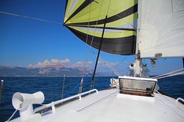 sailing race along the mountainous coast