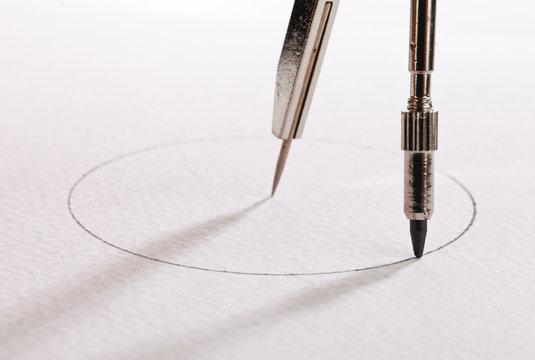 pair of compasses drawing circle