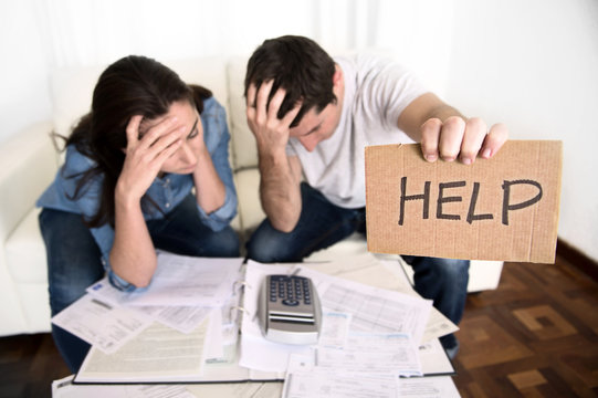 young couple home bad financial situation stress asking for help