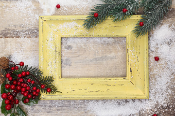 Vintage frame and Christmas decoration on old rusty background.