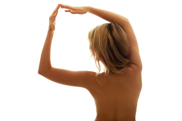 Back view portrait of naked woman with arms up
