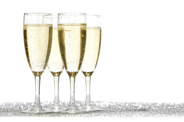 Four champagne glasses