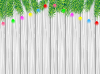 wooden texture with the branches of christmas tree and bright ga