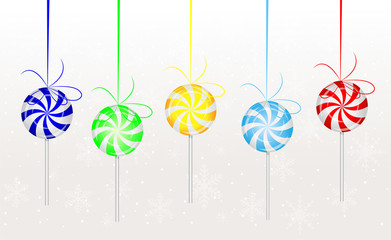 candies lollipops hang on a white background