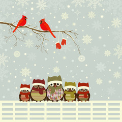Christmas greeting card with family of owls on fence
