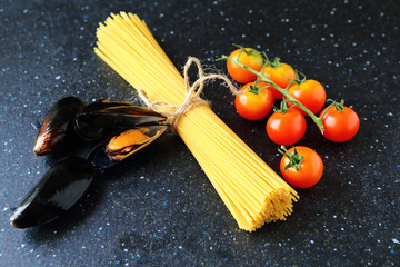 Spaghetti with mussels and tomato on a slate